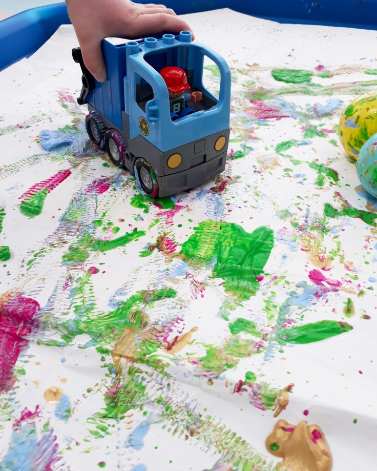mark making in a tuff tray with paint and cars inspired by crocodali lucy volpin interactive picture book templar publishing