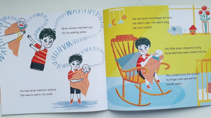 Wren cuddles his baby sister in Wren by Katrina Lehman and Sophie Beer Scribe Scribble Kids Books picture book about a new baby for a sibling