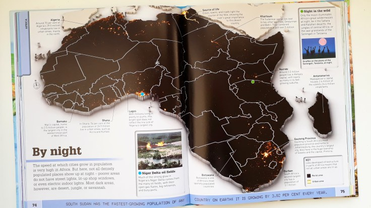 Satellite images continetns by night in What's Where on Earth Atlas for kids DK Books children's non fiction